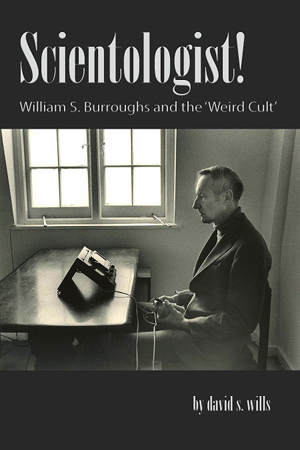The cover of SCIENTOLOGIST! shows Burroughs consulting his e-meter.